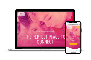 Laptop and mobile phone showing a mobile responsive site